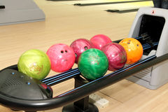 Tenpin Bowling Balls. Image of tenpin bowling balls in different sizes and colours at bowling centre royalty free stock photos