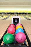 Tenpin Bowling Balls. Image of tenpin bowling balls in different sizes and colours at bowling centre royalty free stock image
