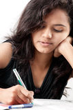 Tense beautiful indian girl writing on paper Royalty Free Stock Photography