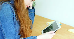Tense business executive using digital tablet stock video