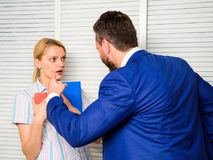 Tense conversation or quarrel between colleagues. Boss discriminate female worker. Discrimination and personal attitude royalty free stock photos