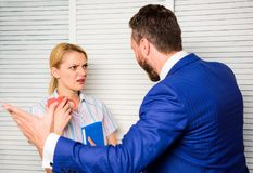 Tense conversation or quarrel between colleagues. Boss and worker discuss working plan. Prejudice and personal attitude stock image