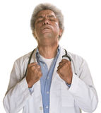 Tense Doctor. Aggravated middle aged doctor with clenched fists Royalty Free Stock Images