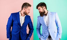Tense face expression competitors. Business competition and confrontation. Business partners competitors in suits with. Tense bearded faces. Businessmen stylish stock photos
