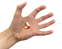 Tense hand with pills Royalty Free Stock Photos
