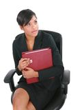 Tense Looking Female Businesswoman Sitting Royalty Free Stock Images