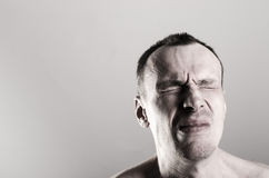 Tense man. A handsome young man in tension Royalty Free Stock Photos