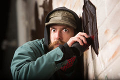 Tense Man Tagging a Wall Royalty Free Stock Image