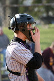 Tense moment. A catcher at a neighborhood practice baseball game observes the action on the field Stock Photos