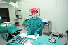 A tense preparation operation instrument nurse Stock Photos