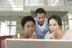 Tensed Business People Using Laptop Royalty Free Stock Images