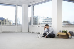 Tensed Businessman In Empty Office Space Stock Photography