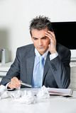 Tensed Businessman Sitting At Desk Royalty Free Stock Photography