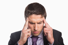 Tensed businessman suffering from headache Royalty Free Stock Image