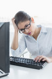 Tensed businesswoman with computer at office Royalty Free Stock Photography