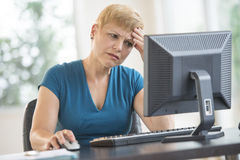 Tensed Businesswoman Using Computer At Desk Stock Images