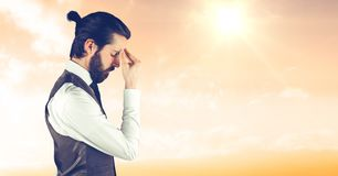 Tensed male hipster in formals against sky Stock Photo