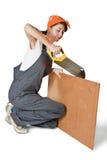 tensed sawing девушки доски Стоковая Фотография RF