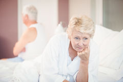 Tensed senior couple on bed Royalty Free Stock Image