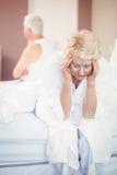 Tensed senior couple in bedroom Royalty Free Stock Photos