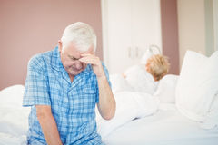 Tensed senior couple at home Stock Images