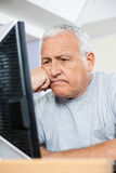 Tensed Senior Man Looking At Computer In Class Royalty Free Stock Image