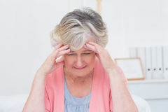 Tensed senior patient suffering from headache Royalty Free Stock Image