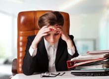 Tensed young business woman Royalty Free Stock Image