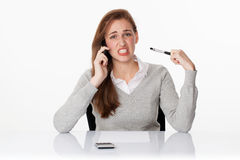 Tensed young female student for trouble at work concept Stock Image