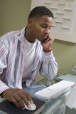 Tensed Young Man Using Computer Stock Photo