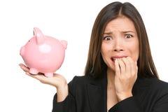 Tensión del dinero - mujer de negocios que sostiene la hucha Imagen de archivo libre de regalías