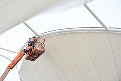 Tensile fabric structure installation. AYUTTHAYA - APRIL 12, 2015:Technician install tensile fabric structure at Ayutthya park shopping center on April 12,2015 Royalty Free Stock Image