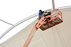 Tensile fabric structure installation. AYUTTHAYA - APRIL 12, 2015:Technician install tensile fabric structure at Ayutthya park shopping center on April 12,2015 Stock Photos