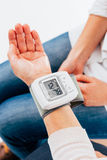 Tensiometer on female hand Royalty Free Stock Photography