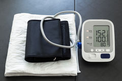 Tensiometer with high blood pressure values indicating hypertens Stock Image