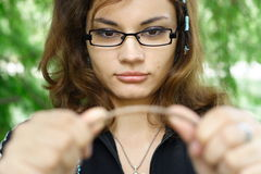 Tension. Young student with glasses in nature, testing tension Stock Photos
