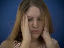 Tension. Woman with hands to her head, headache Royalty Free Stock Photography