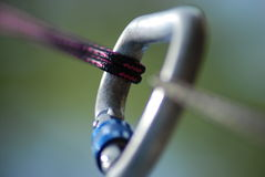 Tension. A carabiner being subjected to tension Royalty Free Stock Photo