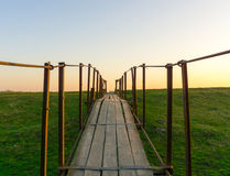 Tension bridge stretching into sunset Royalty Free Stock Image