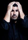 Tension de douleur d'homme d'isolement sur le noir Photos libres de droits