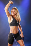 Tension string. Cute blond in workout gear pulls tension string Stock Photography