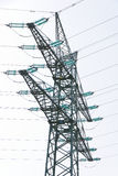 Tension tower with traverses. Of a high-voltage line Stock Photos