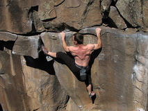Tensiones del escalador de roca Imagen de archivo