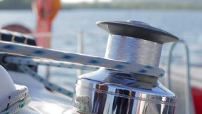 Tensioning sail yacht. Winch on sailing yacht. stock footage