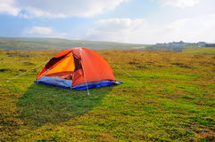 Tent. A colourful tent in the meadow outside Royalty Free Stock Image