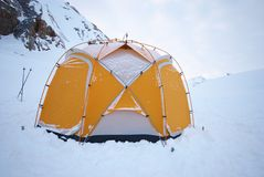 Tent. Yellow camping tent on snow royalty free stock photo