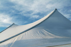 Tent. Large Tent for a wedding. Skies are clear and cool. Looks like a snow covered peak. Sharp focus over entire image Royalty Free Stock Photos