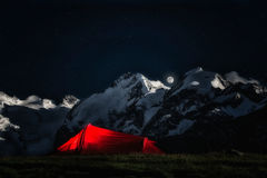 Tent for adventurous climbers. on the background mountains of ic. E in the night in a starry sky with a full moon Stock Image