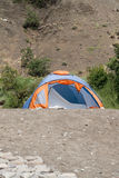 Tent. Against the backdrop of a mountain slope Royalty Free Stock Photos