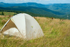 Tent on an alpine meadow Stock Images